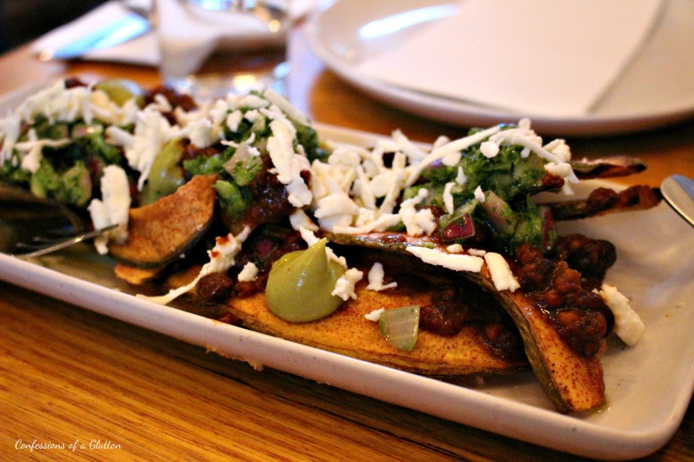 Plantains (v) - Crispy plantains, frijoles, cucumber onion salsa, guacamole and queso fresco ($9)
