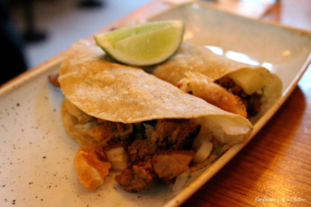 Pork tacos - Achiote marinated pork, chicharrones, roast pineapple and tomatillo salsa ($6 each)
