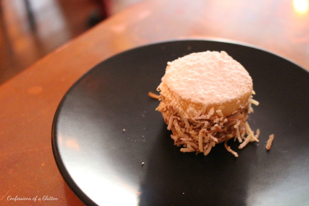 Alfajor ($4) - soft cookie, dulce de leche and coconut